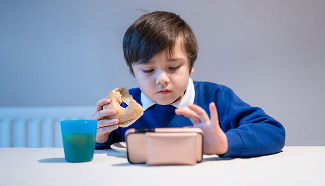 Do you allow your child screen time while eating? Here's why it might be a bad idea and what you can do instead